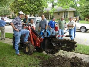 The Woodbridge Irrigation Repair Team trenches a new line